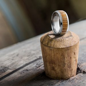 Lashbrook men's ring on a wooden peg