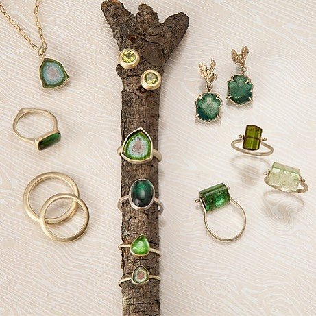 Judi Powers rings, earrings, and a necklace surrounding a branch