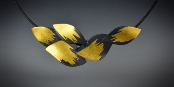 Judith Neugebauer gold and black necklace