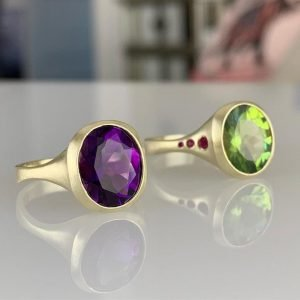 gold, green, and purple rings