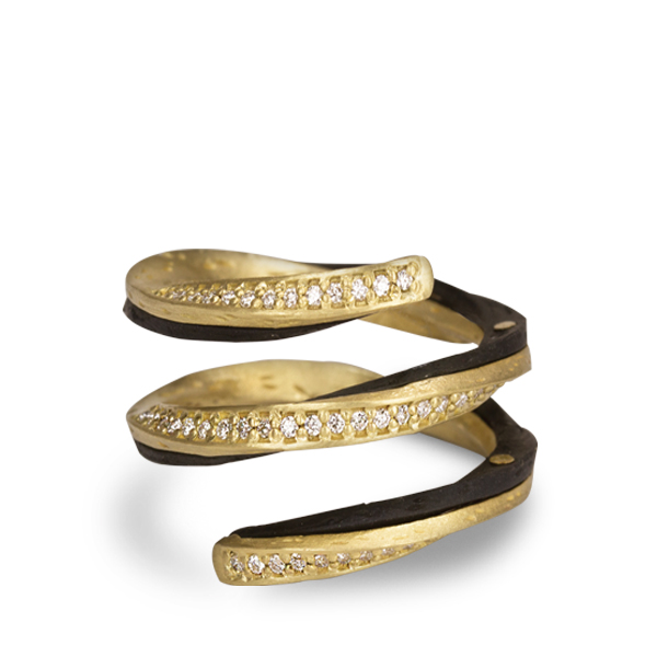 gold, black, and diamond ring