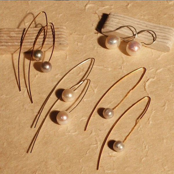 earrings on stone background