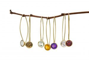 Toby Pomeroy necklaces with white, gold, purple, and red stones