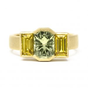 gold, green, and yellow ring