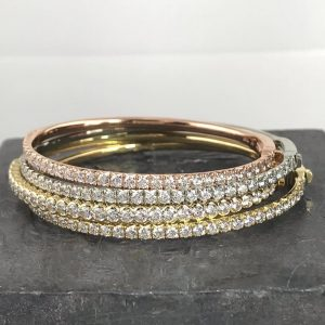 gold, diamond, silver, and rose gold rings