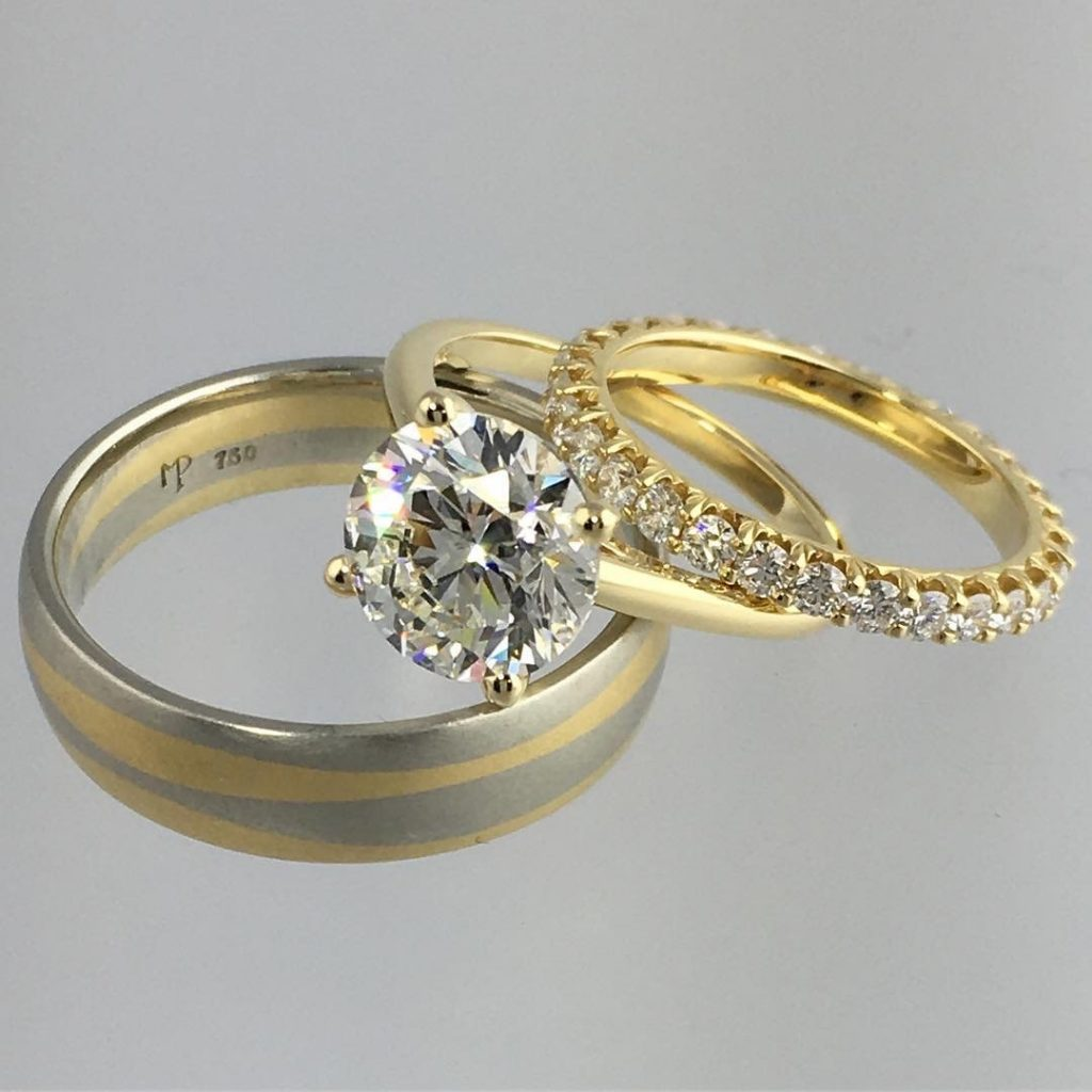 gold, silver, and diamond rings