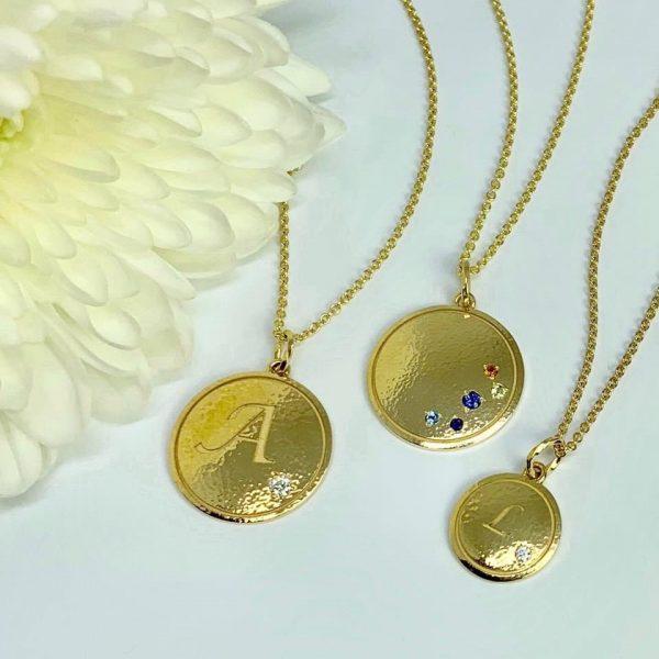 Gold monogrammed pendants