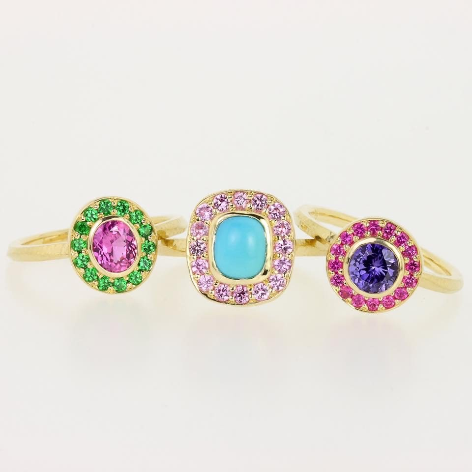 gold, green, blue, and purple rings