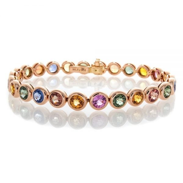 multicolored diamonds in a rose gold bracelet