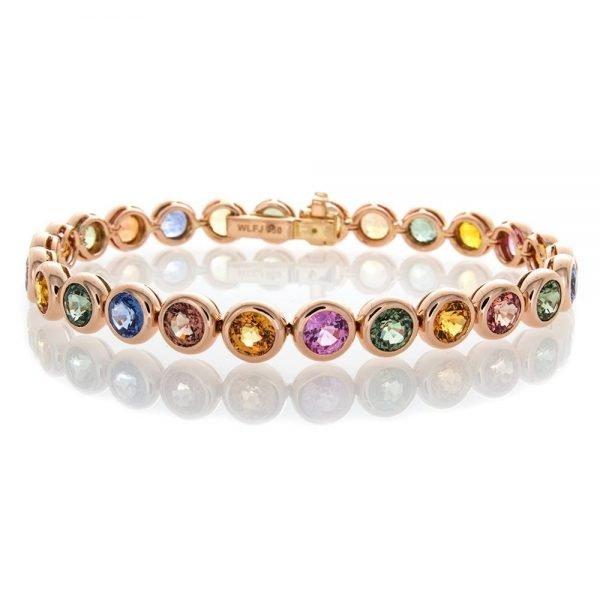 multicolored diamonds in a rose gold bracelet