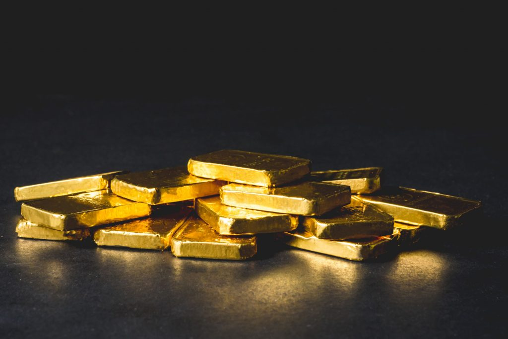 gold bars on a black background