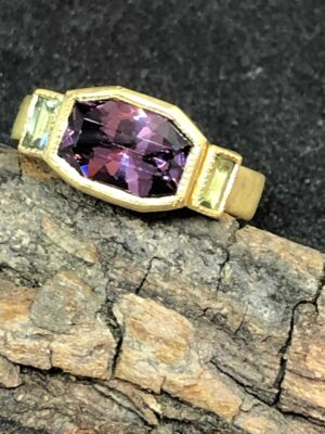 Jennifer Dawes purple spinel ring with ANZA gem